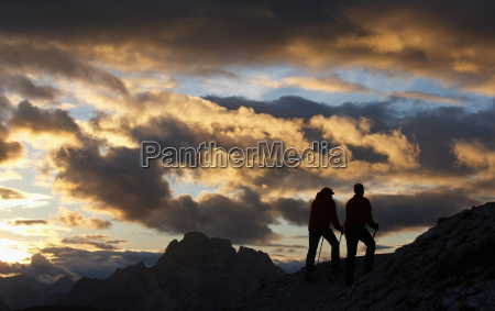 two hikers in the dolomites italy