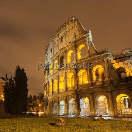 roman coliseum lit up at night