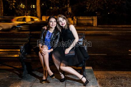 portrait of two female friends sitting