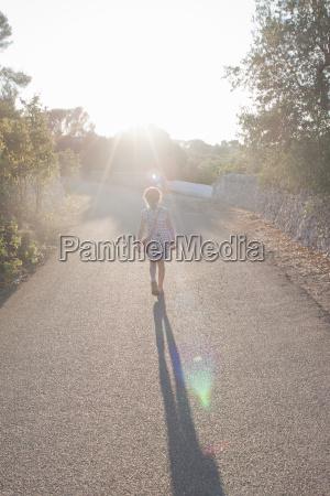 girl walking on rural lane ostuni