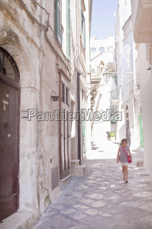 girl walking in street ostuni puglia