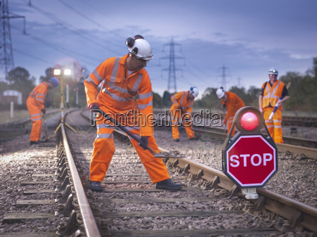 railway maintenance workers on track with