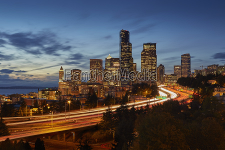 highway and skyline at night seattle