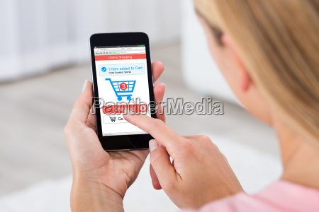 woman shopping online using mobile phone