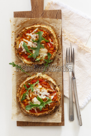 two homemade glutenfree mini pizzas with