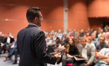 speaker giving talk at business conference