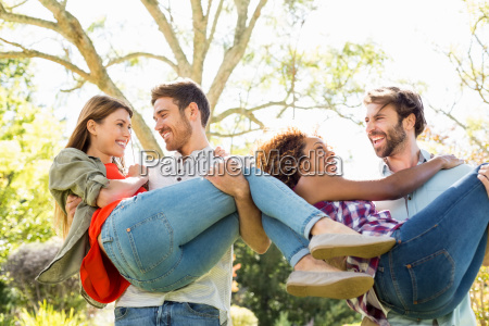 man giving piggyback to woman while