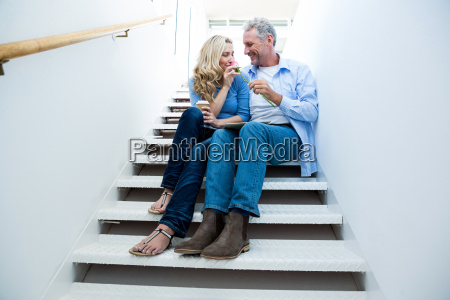 happy man giving flower to woman