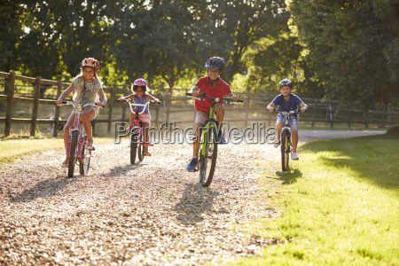 four children on cycle ride in