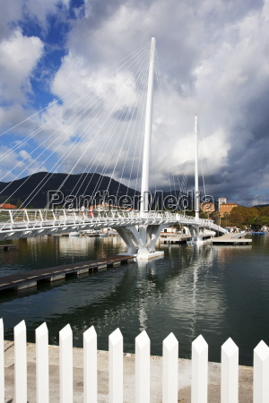 storm clouds over city bridge at
