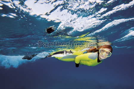 bahamas diver looking at green sea