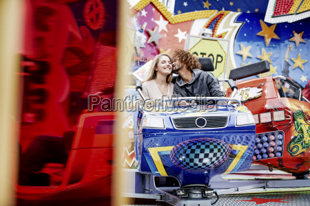 happy couple on a carousel at
