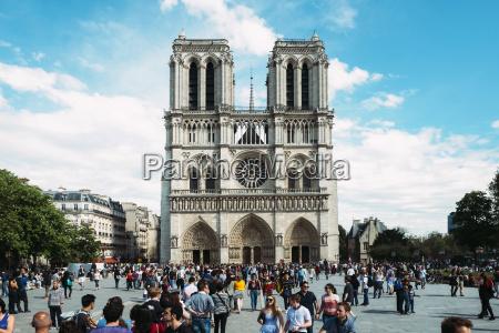 france paris tourists visiting notre dame