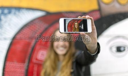 selfie of smiling teenage girl on