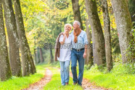 senior couple having leisure walk in