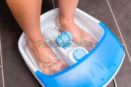 feet of woman in foot bath