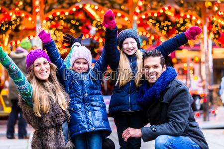 family having fun on christmas market