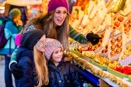 family buying on christmas market decoration