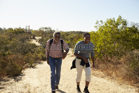 mature couple hiking outdoors in countryside