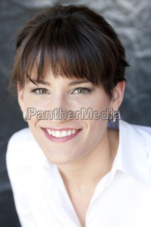 close up portrait of happy businesswoman