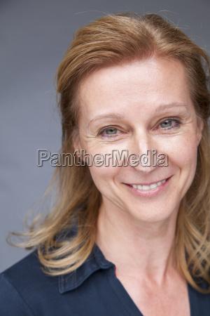 portrait of happy mature woman against