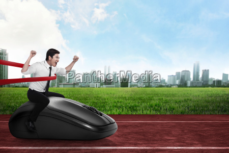 asian business person riding computer mouse