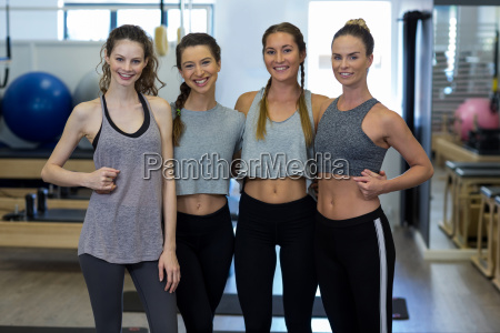 group of smiling women standing together