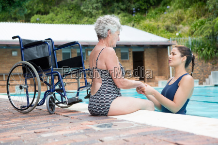 swim coach consoling a disabled senior