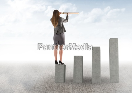 businessman standing on graphic looking at