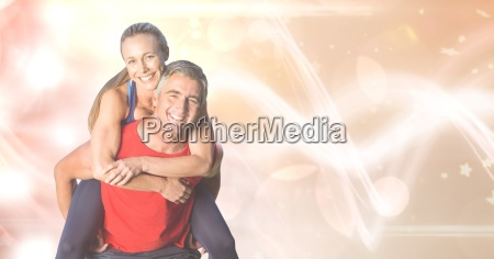 happy fit man giving piggyback ride