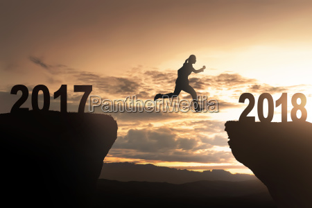 silhouette of woman jump toward 2018