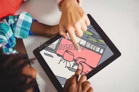 two people looking at 3d drawings