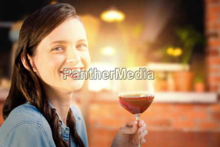 composite image of smiling woman holding