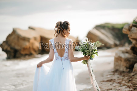 bride with a wedding bouquet on