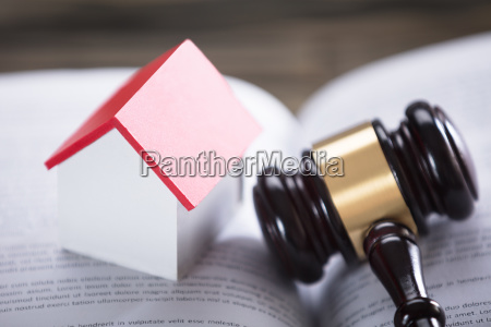 house model and gavel on law