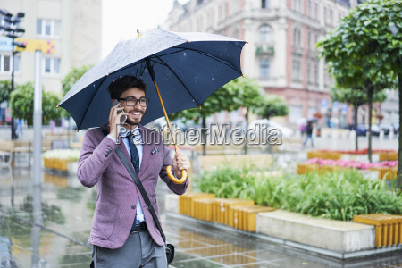 fashionable businessman on the phone on