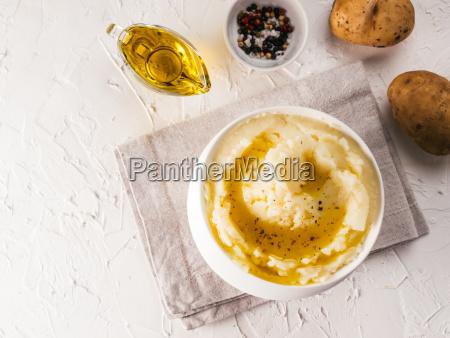 mashed potatoes on white concrete background
