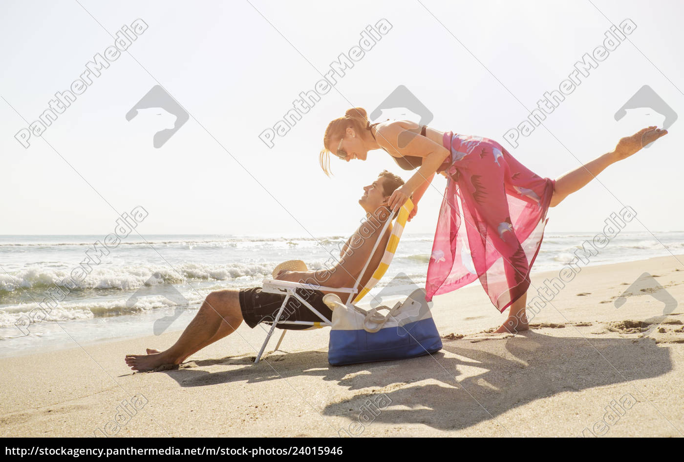 view, of, couple, on, beach - 24015946