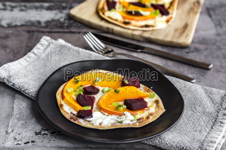 homemade pizza with pumpkin and beetroot