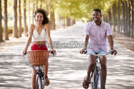 young mixed race couple riding bicycles