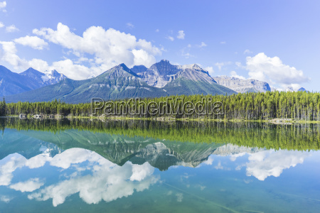 lake by trees against mountains in