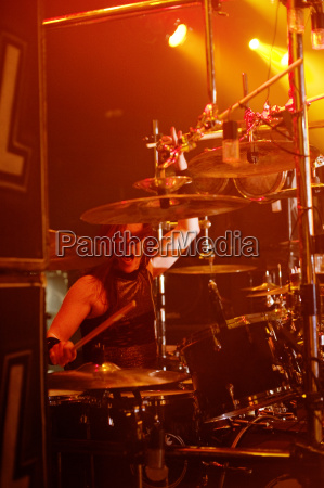 confident man playing drums at music