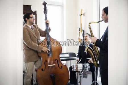 friends practicing in music studio