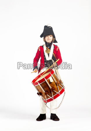 portrait of boy playing drum while