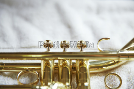 close up of trumpet on fabric