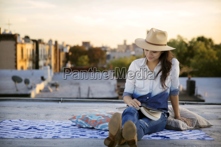 smiling woman sitting by book on