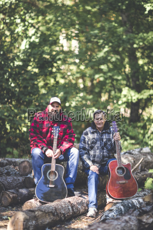 portrait of friends with guitars sitting