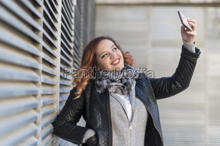 portrait of happy young woman taking