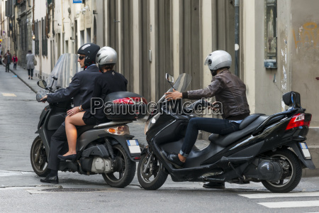 motorcyclists on a street florence italy