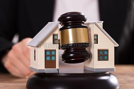 judge striking gavel between split house